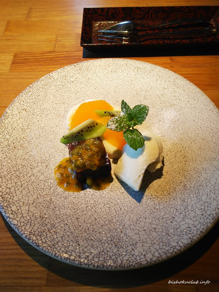 Gateau chocolat with passion fruit, rare cheesecake, tofu mousse with orange and kiwi